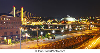 Tacoma downtown at night with Dome and bridge and highway 705. Cable-stayed bridge over Tacoma's Thea Foss