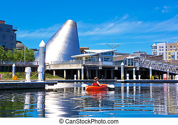 Tacoma downtown marina with Glass Museum Dome and kayaker.