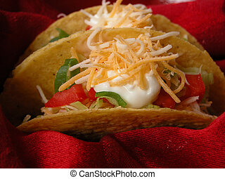 Tacos 2 - These tasty tacos contain meat, lettuce, tomatoes,...