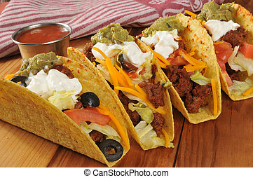 Tacos - Beef tacos with sour cream, guacamole and cheddar...