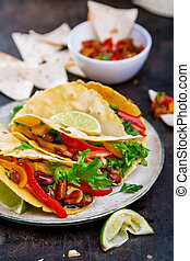 Tacos. Mexican yellow corn tortilla with chicken and vegetables