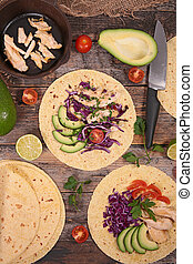 tacos with avocado, chicken and cabbage