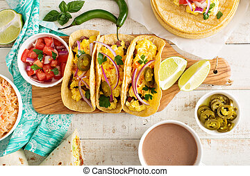 Tacos with  eggs for breakfast and variety of mexican dishes