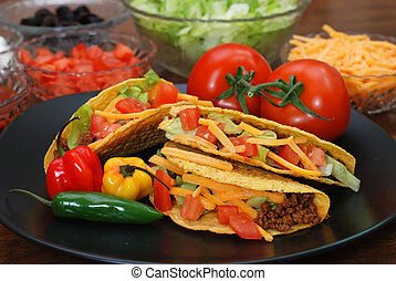 Tacos with Ingredients - Prepared tacos with tomatoes,...