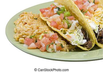 tacos with rice closeup - closeup of three crunchy tacos...