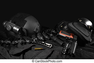 Tactical gear laying composition. - Black military...