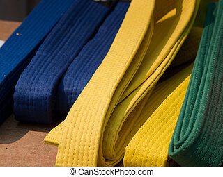 Tae Kwon Do belts on the table.