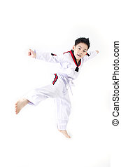 Taekwondo action by a asian cute boy - little asian smile...