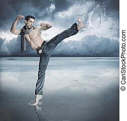 Taekwondo fighter training in the nature