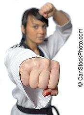Taekwondo. Woman in a kimono on the white background -...