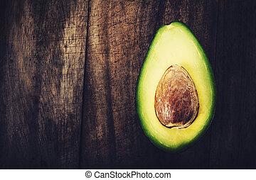 tafel, de ruimte van het exemplaar, achtergrond, organisch, fris, houten, afsluiten, oud, halved, voedingsmiddelen, avocado., op, avocado