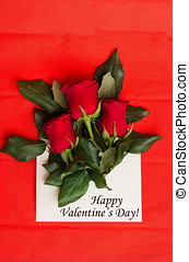 Tag Happy Valentine's Day with bouquet of red roses in envelope on red background