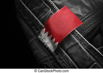 Tag on dark clothing in the form of the flag of the Bahrain