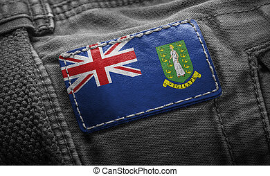 Tag on dark clothing in the form of the flag of the British Virgin Islands
