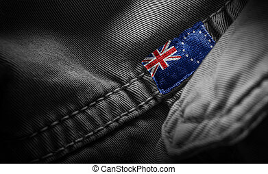 Tag on dark clothing in the form of the flag of the Cook Islands