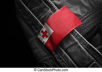 Tag on dark clothing in the form of the flag of the Tonga
