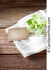 Tag on rustic wooden table with burlap - Blank tag on a ...