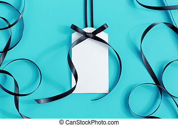 Tag with black ribbon