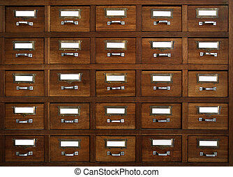 tagged drawers - Rows of little drawers with white empty...