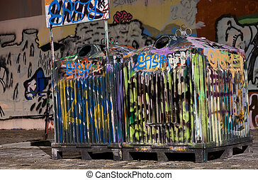 Tagged trash cans - Picture of two tagged trashcans in a...