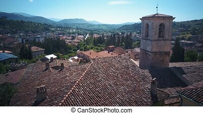 Tagliacozzo, AQ. Italy. Aerial view of old city center with old houses and town hall. Drone flies over the roofs