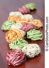 Tagliatelle - Assortment of colorful tagliatelle pasta dyed ...