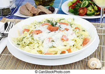 Tagliatelle pasta with cream, salmon and anise