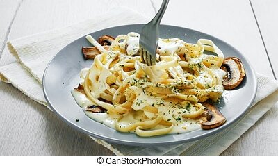 Tagliatelle Pasta with Mushrooms and creamy bechamel sauce -...