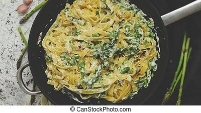 Tagliatelle pasta with ricotta cheese sauce and asparagus ...