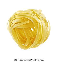 Tagliatelle - Uncooked raw dry tagliatelle pasta isolated on...