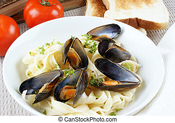 Tagliatelle with Mussels in a white bowl