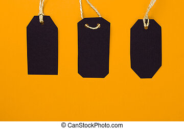 Tags of stores. top view on a yellow background, sale, black Friday.