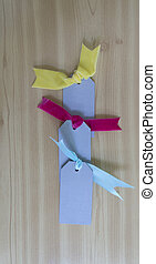 Tags with velvet bows colorful
