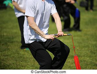 tai chi, martial arts, atleet, maakt, moties, met, zwaard