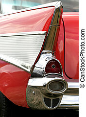 Tail light of a red classic car in auto show