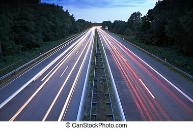 Tail Lights - Cars speeding on a highway
