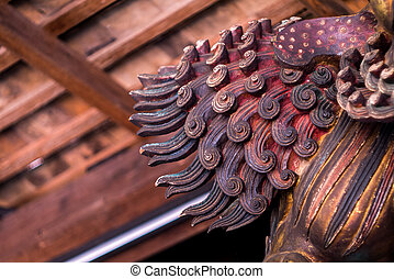 Tail of Chinese carving wooden lion