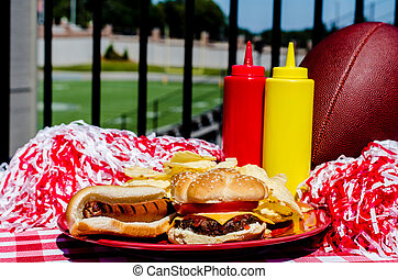 Tailgating Party - Tailgating party with cheeseburger, hot...