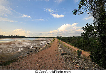 Tailings Pool with the runoff following the processing of...