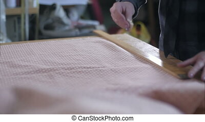 Tailor marking fabric with chalk for cutting