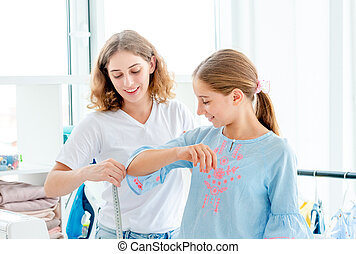 Tailor measuring her client