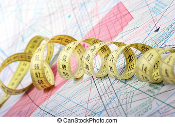 tailor measuring tape on patterns of clothing