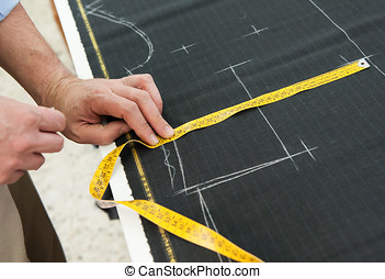 Tailor or clothing designer marking out a pattern