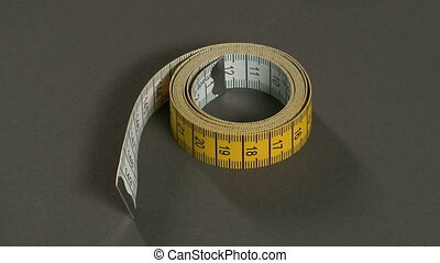Tailor Picking Up the Tape Measure - Tailor measuring...