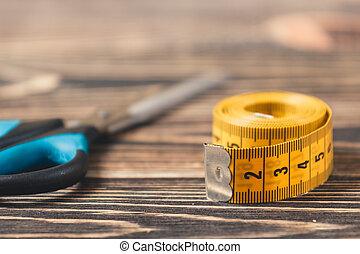 tailor tool. meter and scissors