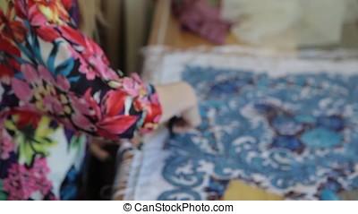 Tailor.Hands notch tailor tailor's scissors cloth. Female...