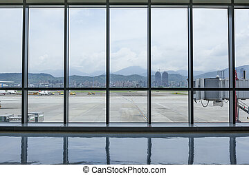 Taipei Songshan Airport Terminal interior sight with outside...