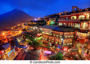 Jiufen, Taiwan hillside with old teahouses at dusk.