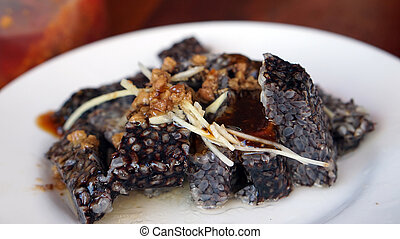 Taiwanese food, goose blood sticky rice sausage with ginger...