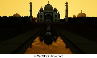 Taj Mahal against beautiful morning sun, tilt
